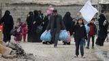 East Mosul returns to life, but danger lurks
