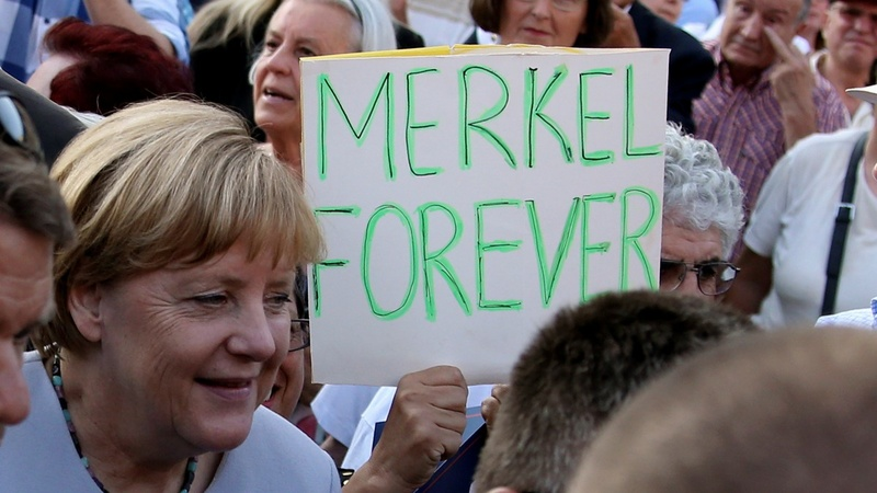 Burdened but unbowed, Merkel to seek 4th term