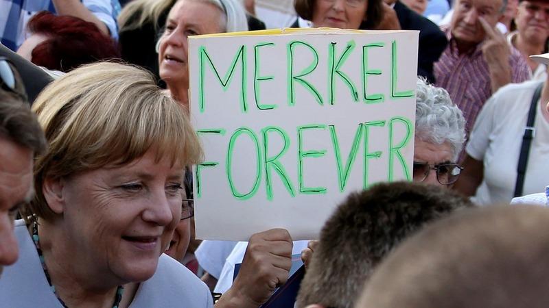 Burdened but unbowed, Merkel to seek 4th term