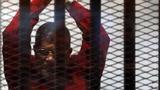 Egypt overturns life sentence for Mursi