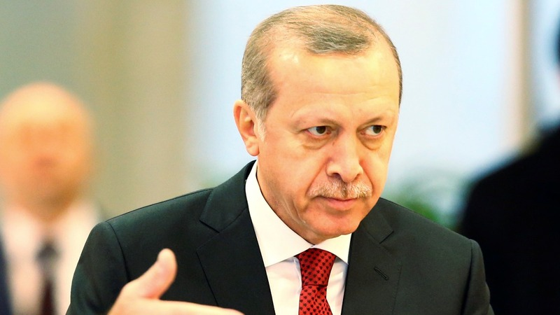 Turkey threatens to open migrant 'gates' if pushed