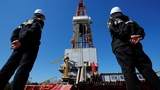 Oil slips as output deal tensions rise