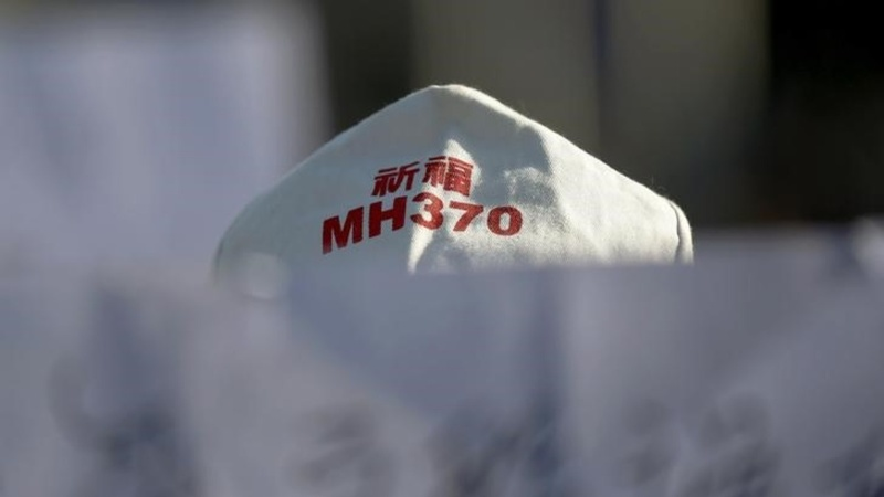 INSIGHT: MH370 relatives fly to Madagascar