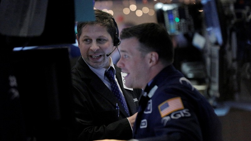 Dow soars 300 pts; scores record high