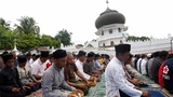 INSIGHT: Friday prayers in Indonesia's disaster zone