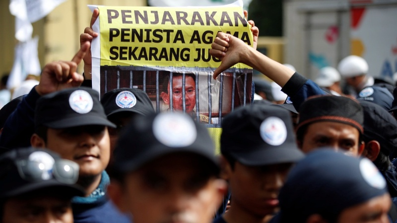 Jakarta governor put on trial for blasphemy