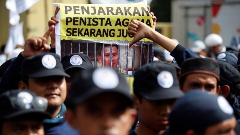 Jakarta governor put on trial for blasphemy