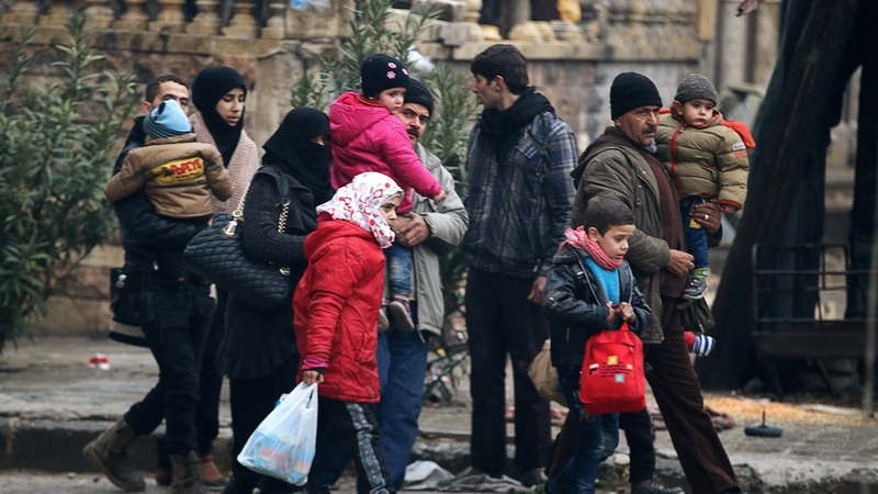 INSIGHT: Thousands flee Aleppo army advance