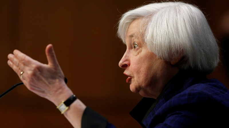Fed hikes rates as economic outlook improves