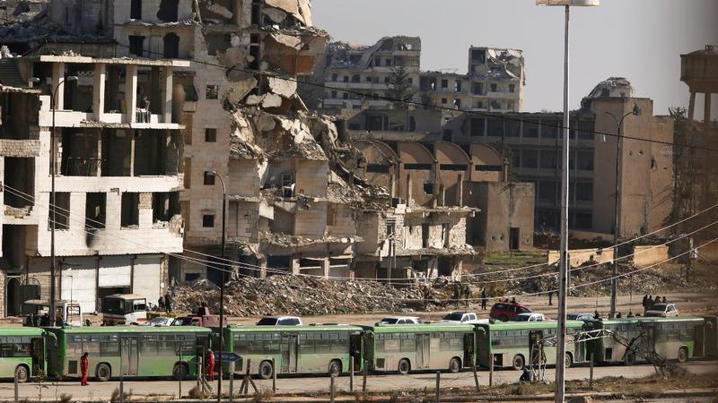 Aleppo evacuation begins under fire