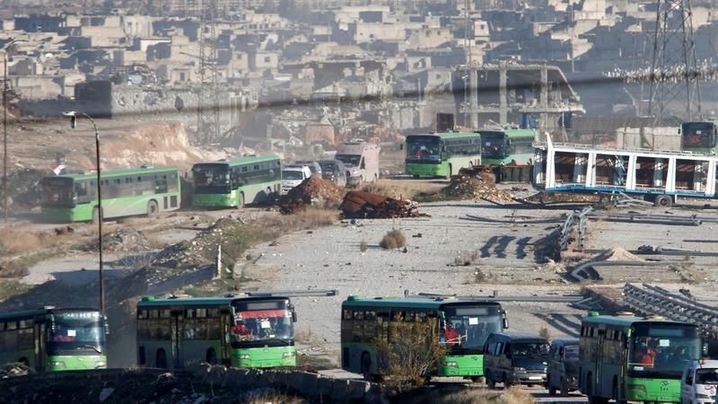 First convoys evacuate Aleppo's rebel enclave