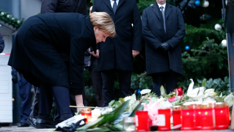 INSIGHT: Merkel visits site of Berlin market attack