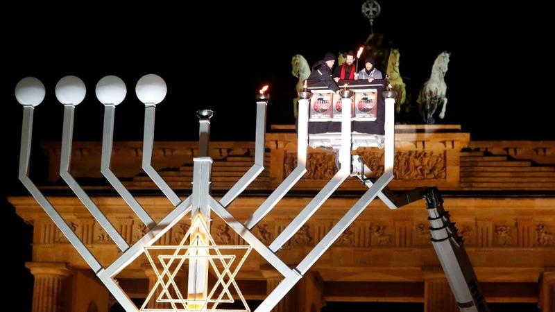 INSIGHT: Berlin menorah lit for truck attack victims