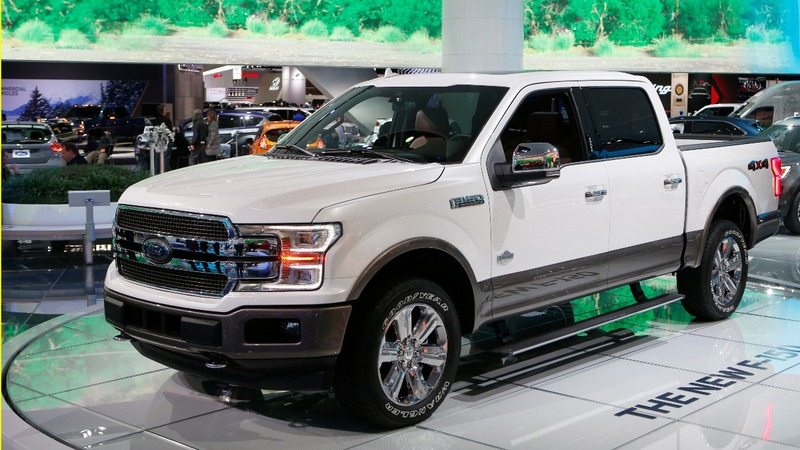 Trucks and SUVs roll over cars at Detroit auto show