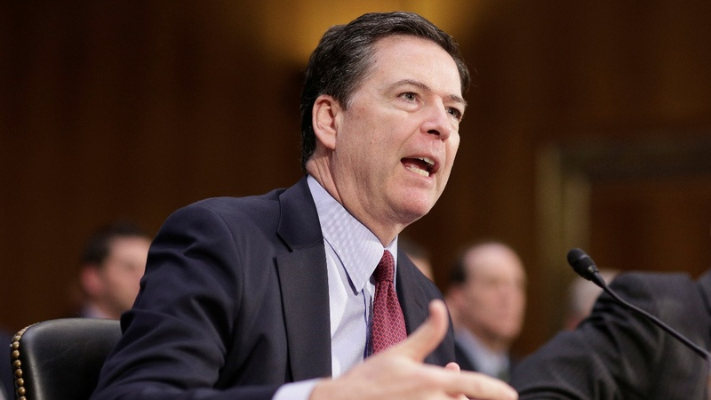 Clinton looms large at intel hearing with Comey