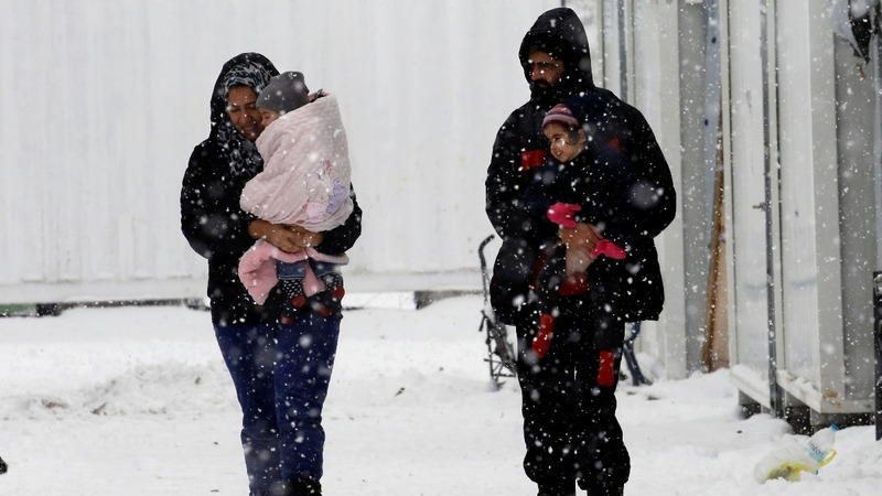 INSIGHT: Refugees brave snow in Greek camps
