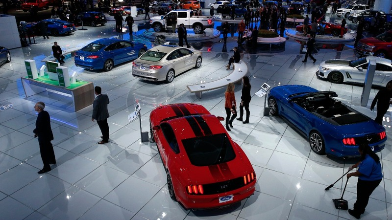 Automakers at Detroit show dance to Trump's mariachi