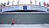 Davos elites walking in Trump's shadow