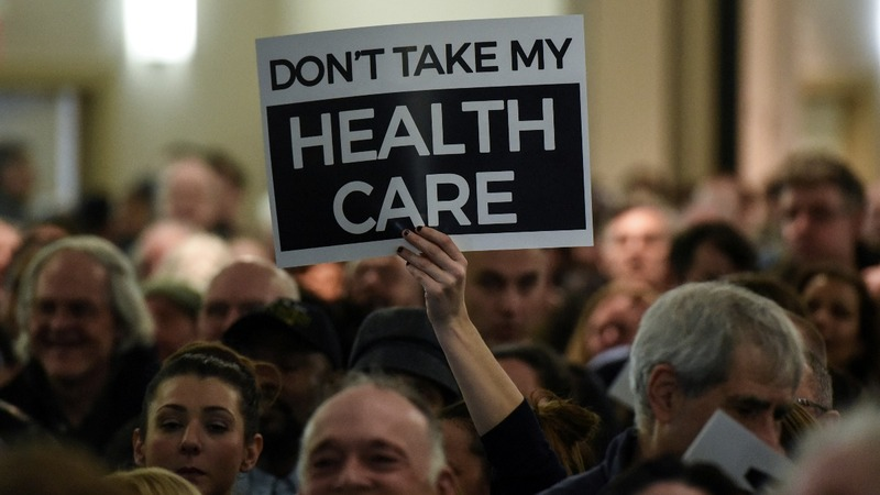 Thousands rally to save Obamacare as Trump hints at new plan