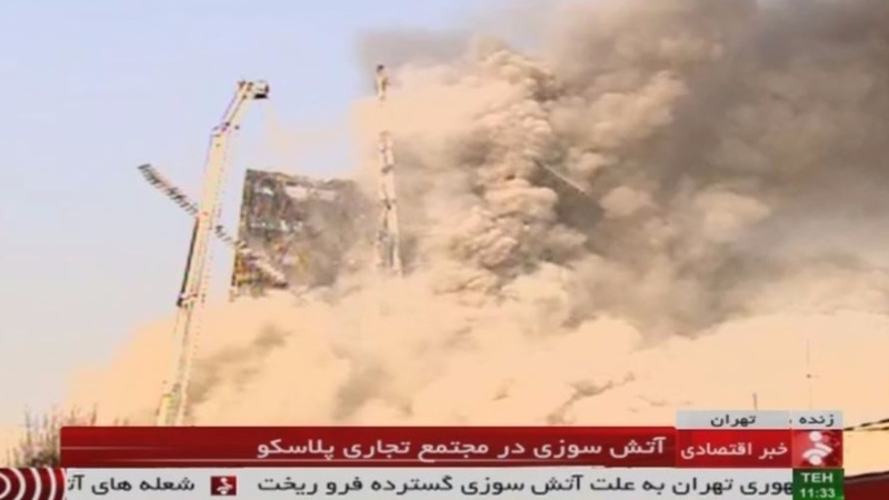 Burning Tehran tower block collapses