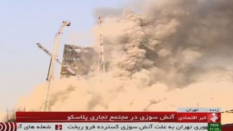 Burning Tehran tower block collapses