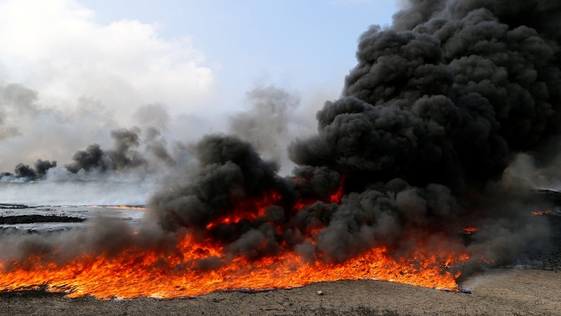 Iraqi locals, environment suffer ISIS oil fires