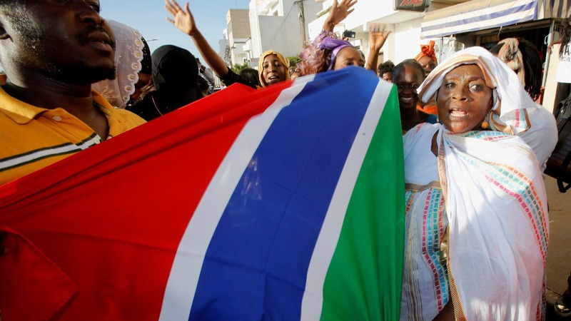 Gambia's Barrow sworn in as conflict looms
