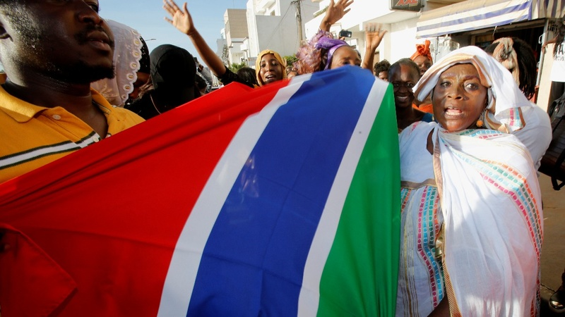 Gambia's Barrow sworn in as conflict looms