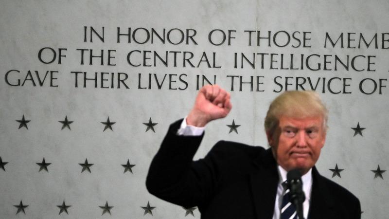 Trump pledges backing for CIA, slams media