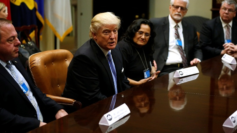Trump pushes jobs, fires off orders in Week 1 kick-off