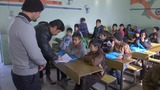School resumes in war-torn east Mosul