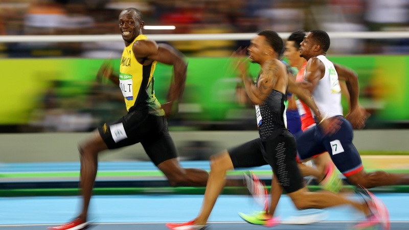 Bolt stripped of gold after teammate's doping test