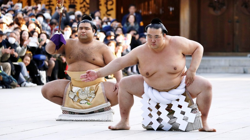 INSIGHT: Sumo champ honoured in Tokyo