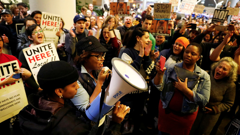 INSIGHT: Airport protests against Trump's refugee ban