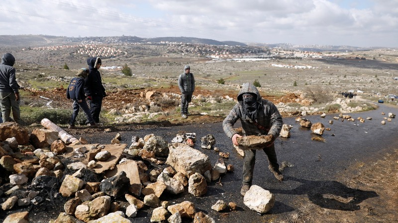 Israel begins evicting settlers from illegal outpost