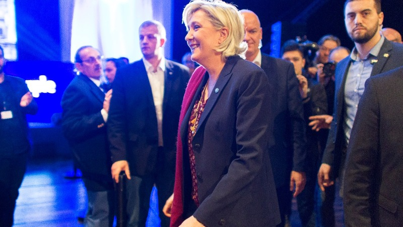 French hopefuls Macron and Le Pen trade barbs