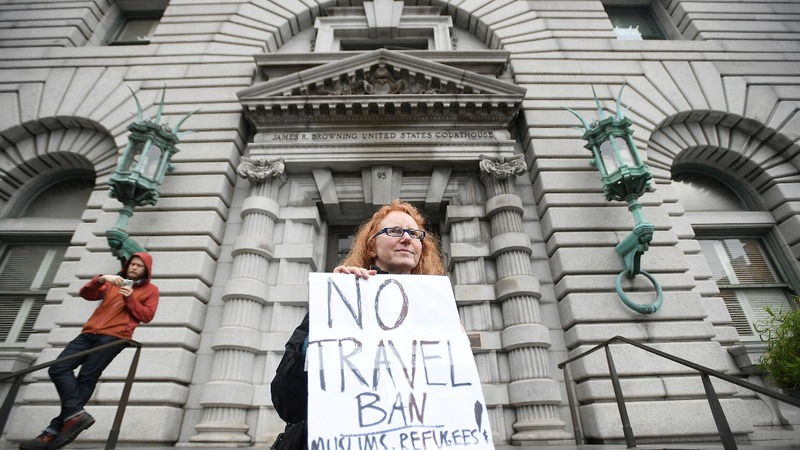 In blow to Trump, U.S. court upholds suspension of travel ban