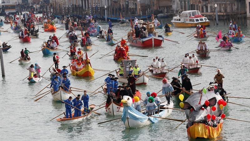 INSIGHT: Carnival boats delight Venice visitors
