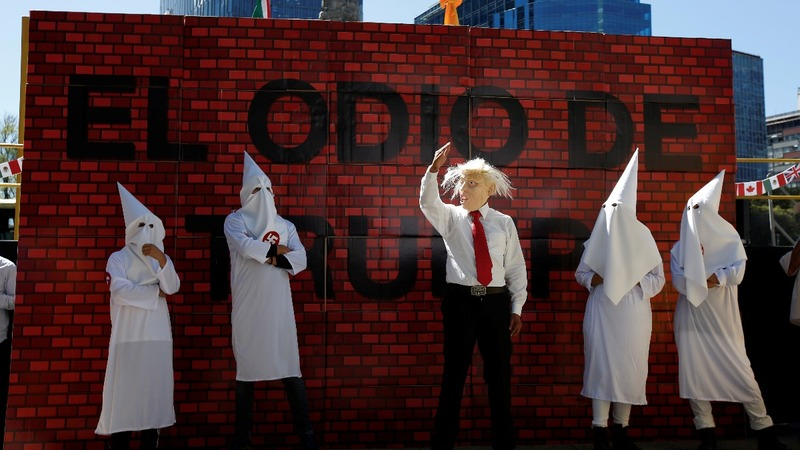 Mexico City performance fells Trump 'wall' amid cheers
