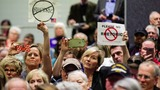 INSIGHT: Anger erupts at Congressional town halls