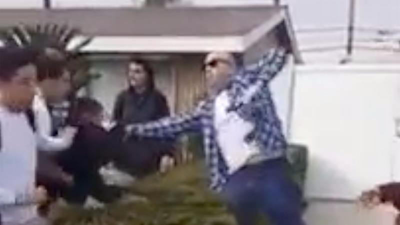 California police arrest protesters over off-duty cop scuffle