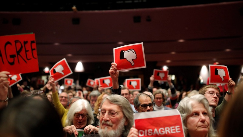 Raucous town halls highlight GOP lawmakers at risk