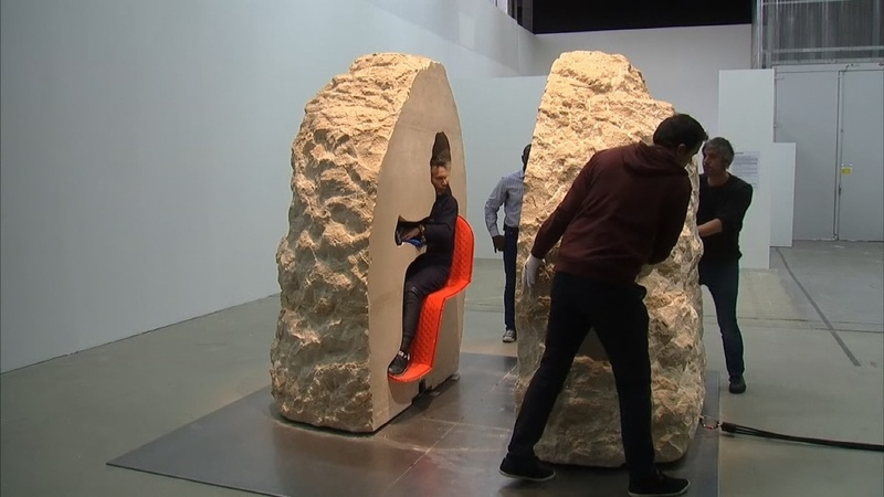 French artist emerges from rock after one week