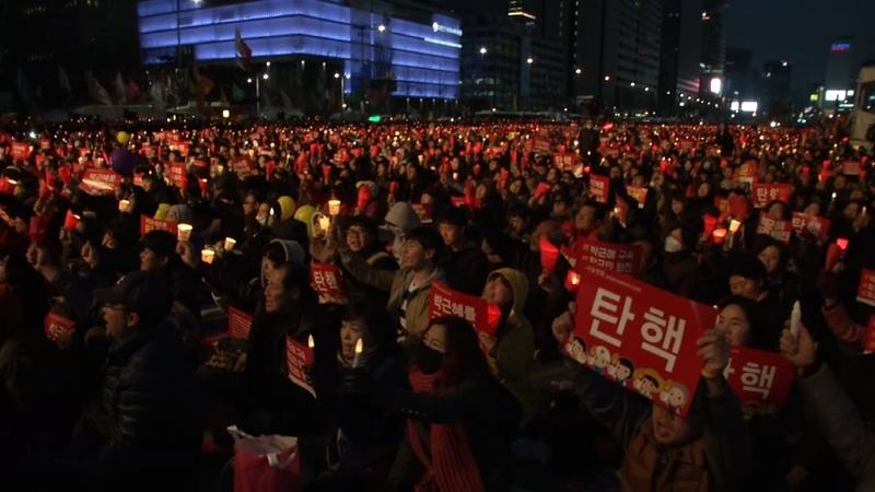 INSIGHT: South Koreans in mass rally