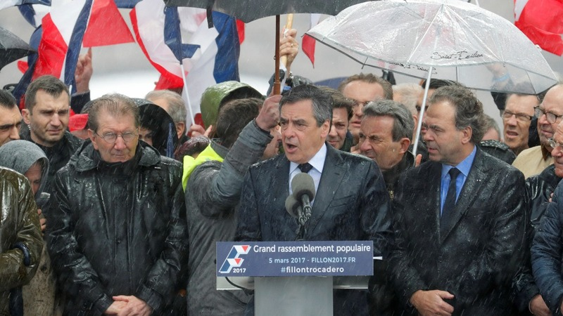 Fillon fights back in Paris rally