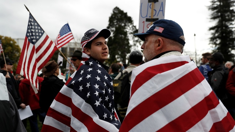 Flags, and a few fists, fly at pro-Trump rallies