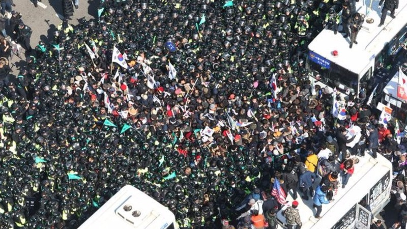 S. Korean court ousts president, two dead in protests