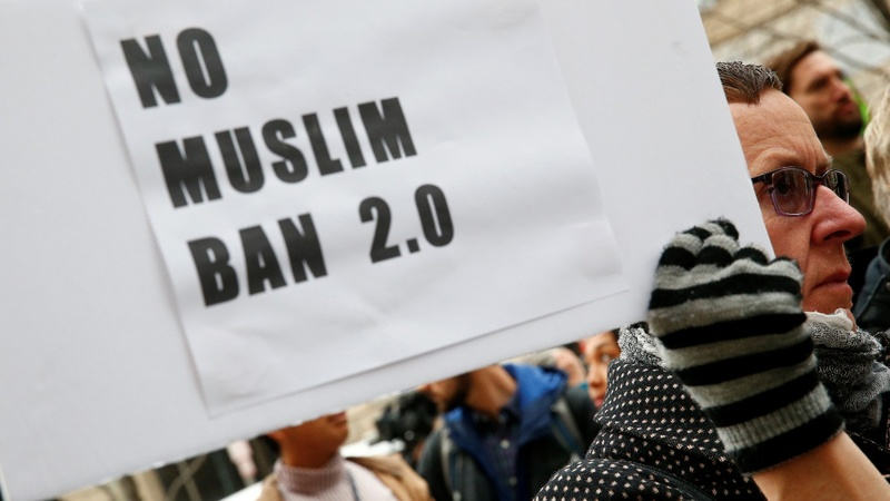 Courts hear last-ditch efforts to block revised travel ban