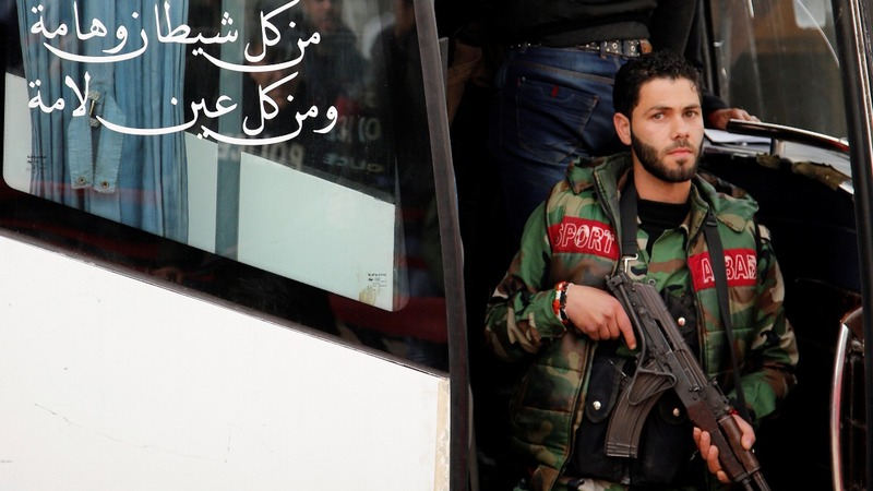 Rebels board buses from last Homs bastion