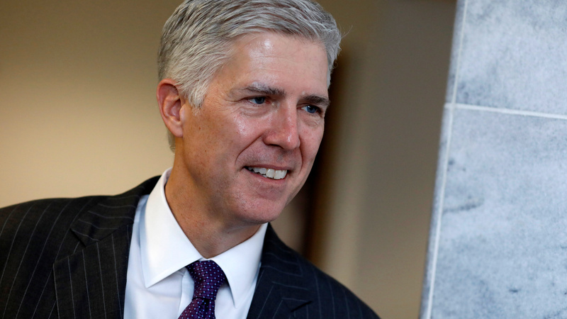 Gorsuch faces test over Trump travel ban at hearing